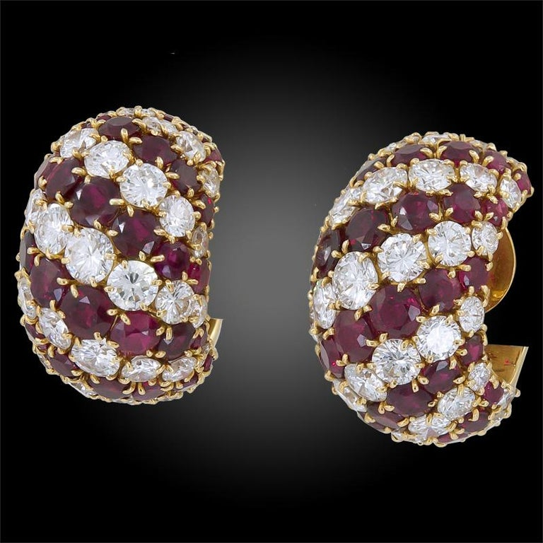 A pair of ruby and diamond 'Stripe' earrings by Van Cleef & Arpels, the earrings designed as curved bombe-style ear clips set throughout with alternating rows of round brilliant cut diamonds and ruby, mounted in 18k white gold, with French