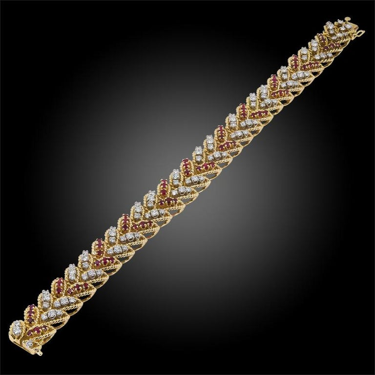 An 18k yellow gold bracelet, set with brilliant-cut diamonds and ruby, signed Van Cleef & Arpels, 1970s. dimensions approx. 7 3/4″ long