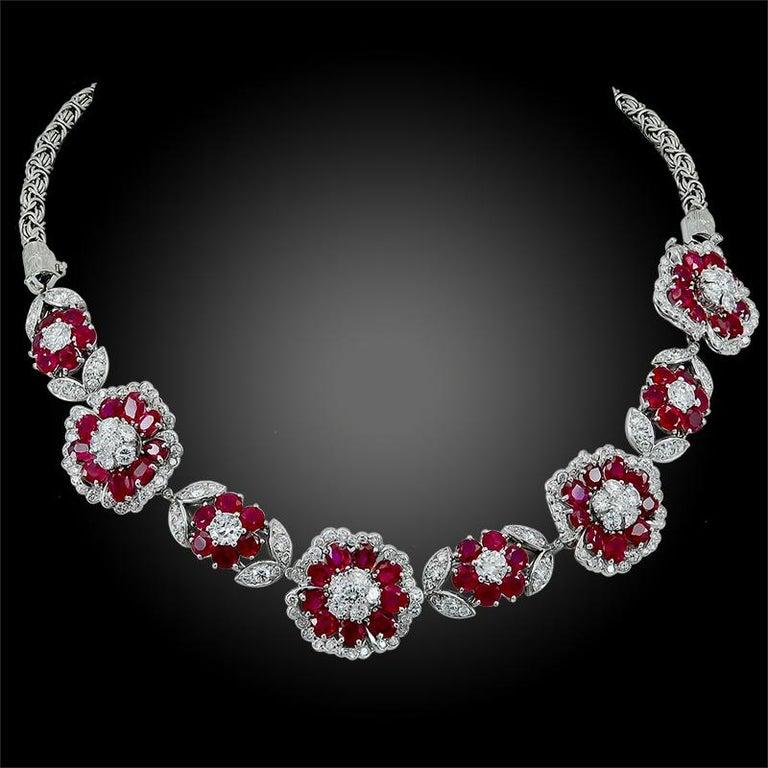 Platinum diamond and Burma no-heat ruby flower motif bracelet/necklace, signed Van Cleef & Arpels. accompanied by Gubelin certificate