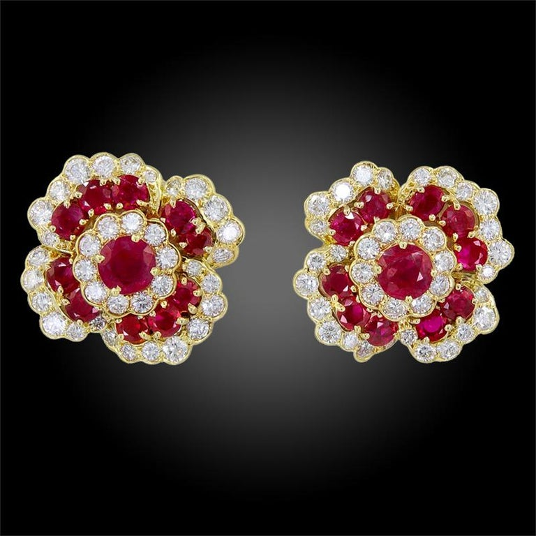 A pair of 18k yellow gold earrings and necklace, set with brilliant-cut diamonds and ruby, signed and numbered by Van Cleef & Arpels. This comes with a certificate of authenticity. Circa 1980s