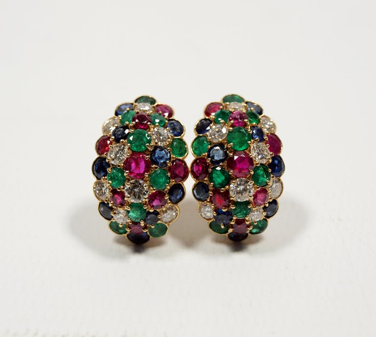 A pair of Van Cleef & Arpels yellow gold, diamond, ruby, sapphire and emerald earclips, containing eight round brilliant cut diamonds weighing approximately 1.15 carats total, eight round mixed cut rubies measuring approximately 2.40-4.00 mm in