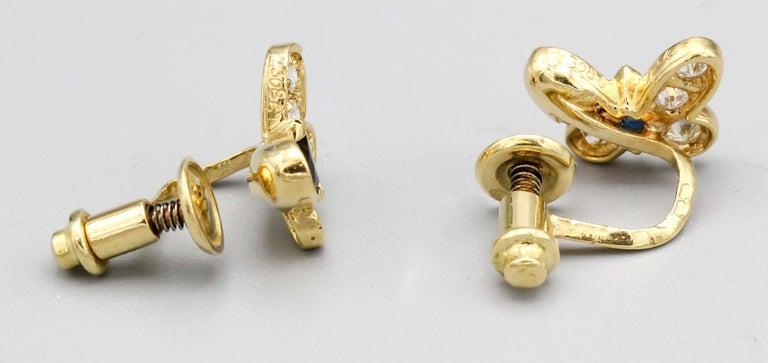 Fine diamond, blue sapphire and 18K yellow gold earrings resembling