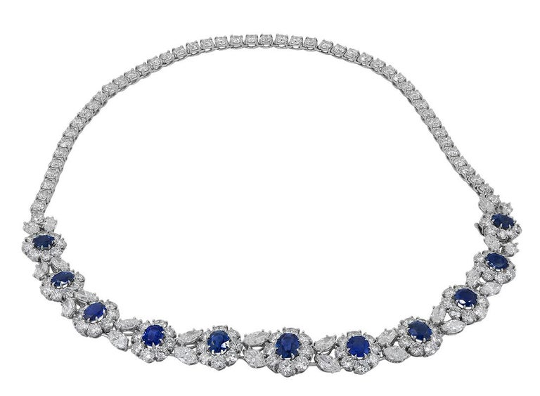 VAN CLEEF & ARPELS Diamond, Sapphire Flower Necklace  Measures total length is approx. 16.25″, chain only approx. 9.25″, the smallest flower is approx. 0.44″ x 0.39″ x 0.26″ and the largest is approx. 0.54 x 0.50″ x 0.25″  Made in the USA. Numbered
