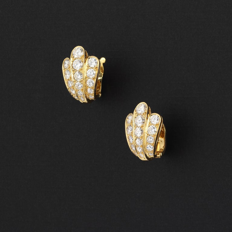 Van Cleef & Arpels dazzling vintage scallop shell-shape earrings showcasing approximately 3 carats of finest white diamonds and set in 18 karat yellow gold. The scallop shape gracefully fans out out from bottom to the top of the earrings and