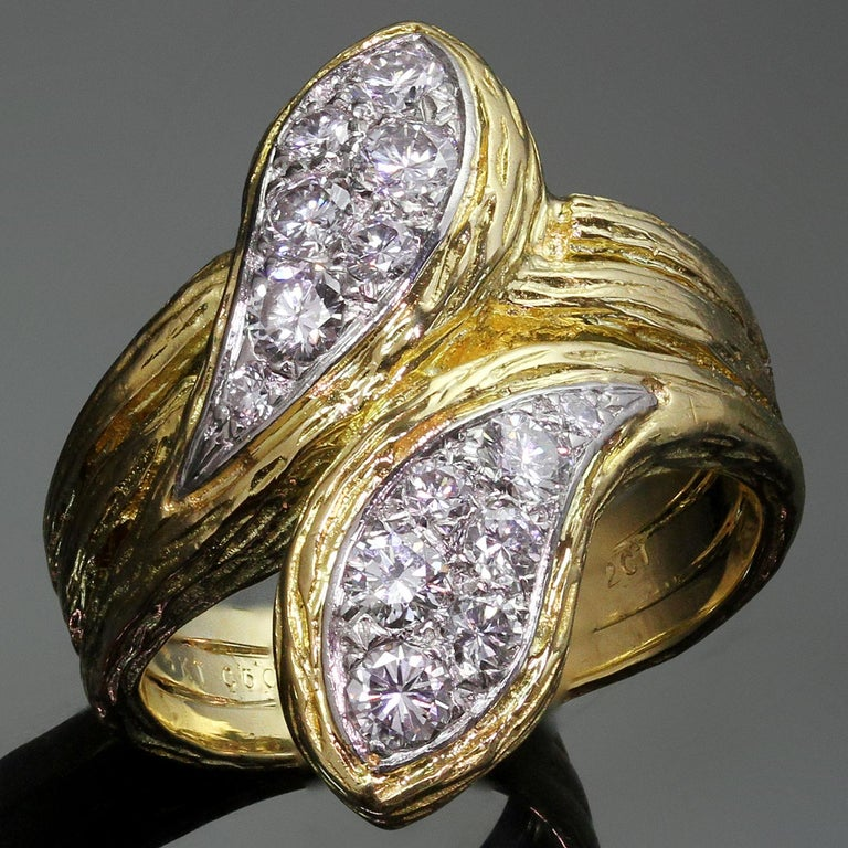 This classic vintage Van Cleef & Arpels ring is crafted in 18k textured yellow gold and pave-set with round brilliant D-F VVS1-VVS2 diamonds weighing an estimated 0.72 carats. Circa 1970s. Measurements: 0.55