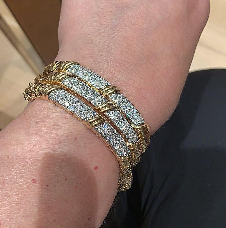 VAN CLEEF & ARPELS Diamond Three Bracelets A stylish set by Van Cleef & Arpels comprising three 18K gold hinged bangles with pave-set brilliant diamond accents, signed Van Cleef & Arpels, circa 1970s. Condition: Good - Previously owned and gently