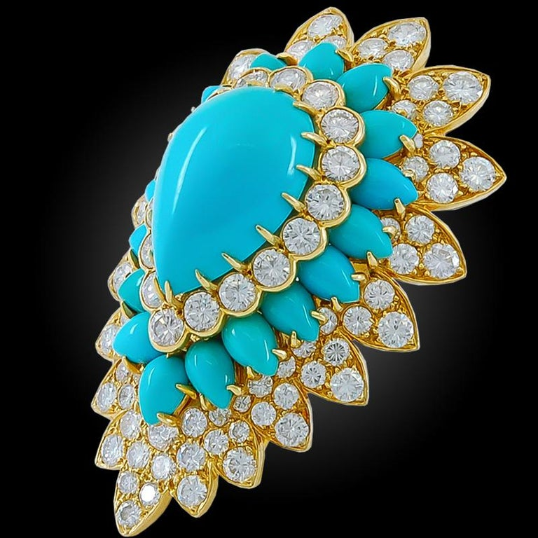 A remarkable vintage brooch by Van Cleef & Arpels that dates back to the 1960s, crafted in a pear-shaped design made of 18k yellow gold, embellished with polished turquoise and diamonds, numbered, French assay mark. Dimensions approximately 2″ x 1