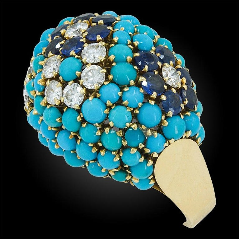Van Cleef & Arpels Bagatelle Turquoise Bombe Ring in 18k Yellow Gold.  A notable retro-style ring from Van Cleef & Arpels converging two designs emblematic of the Maison: the domed voluminous forms of