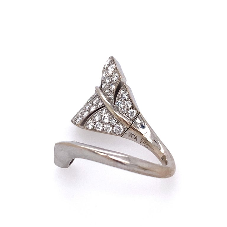 Designed as a leaf, set with pear-shaped and round brilliant-cut diamonds, with swivel mechanism to allow the leaf to be worn between the fingers or on one finger; estimated total diamond weight: 1.40 carats; mounted in 18k white gold; size: 5;