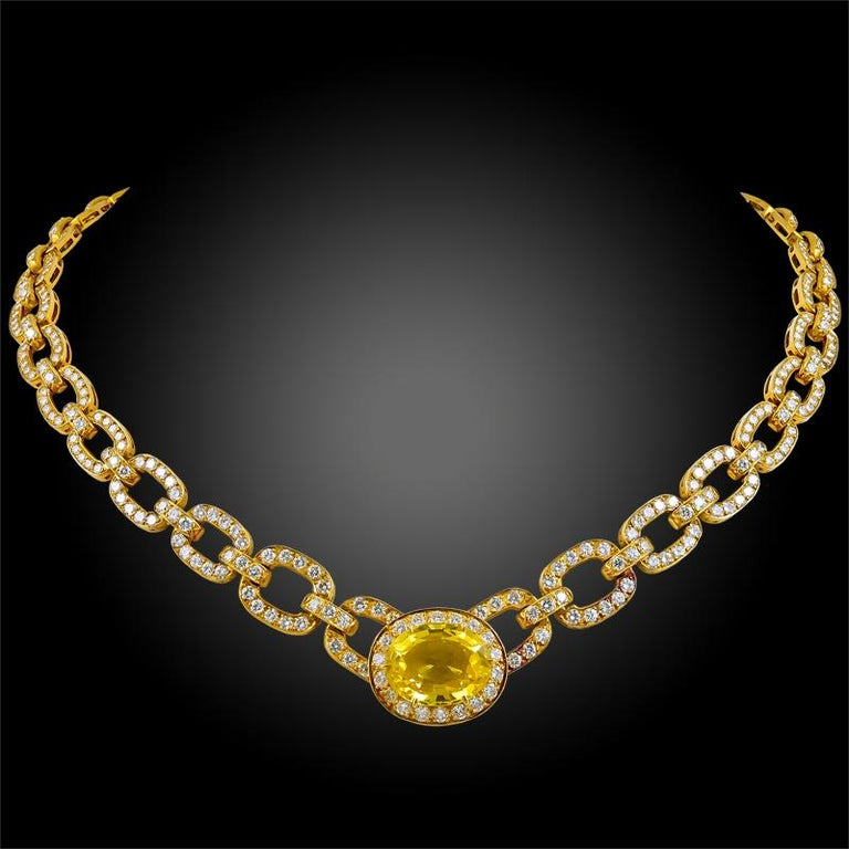 An impeccable trio by Van Cleef & Arpels, this 1980's set is comprised of a necklace, earrings, and ring, all of which are finely set with an opulence of brilliant-cut diamonds and radiant oval shaped yellow sapphires, finely mounted in 18k yellow
