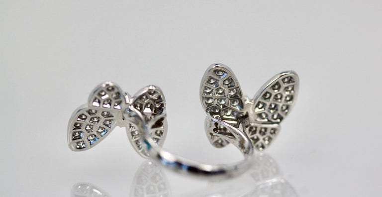 This ring is the double butterfly in all Diamonds.  This ring is in great condition, being worn only a few times.  F color, VS clarity size 54 or US 7.  I also have the matching earrings in another listing