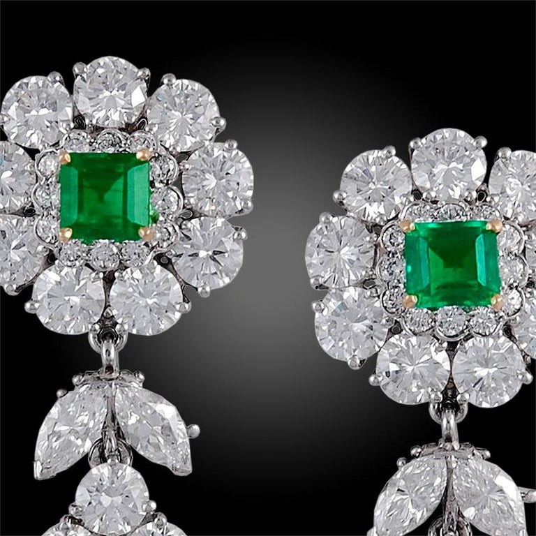 An elegant pair of 1970s  Van Cleef & Arpels pendant earrings. Each detachable pendant is designed as a pear-shaped drop set with a vivid green pear-shaped emerald framed by two rows of brilliant-cut diamonds and is suspended from two decorative