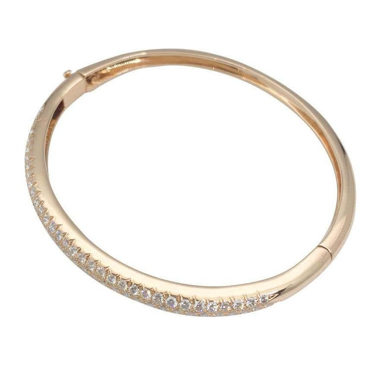 18k yellow gold  bangle bract encrusted with tree rows of diamonds with total weight of 2,50 carats  With the makers hallmark and signed VCA