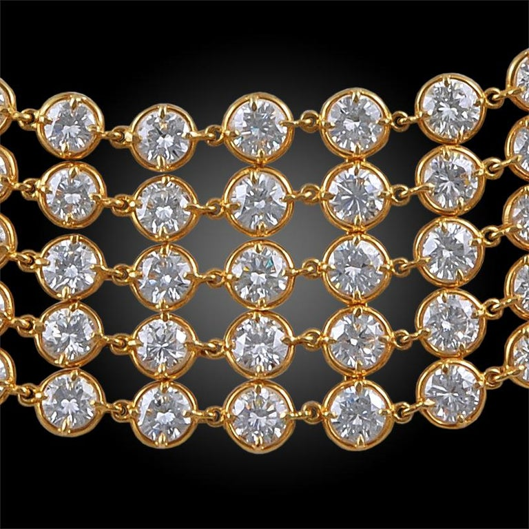 An exceptional and highly flexible necklace by Van Cleef & Arpels that dates back to the 1990s, designed as five rows of graduated round-cut diamonds of exceptional brilliance, exquisitely crafted in 18k yellow gold links. Signed Van Cleef &