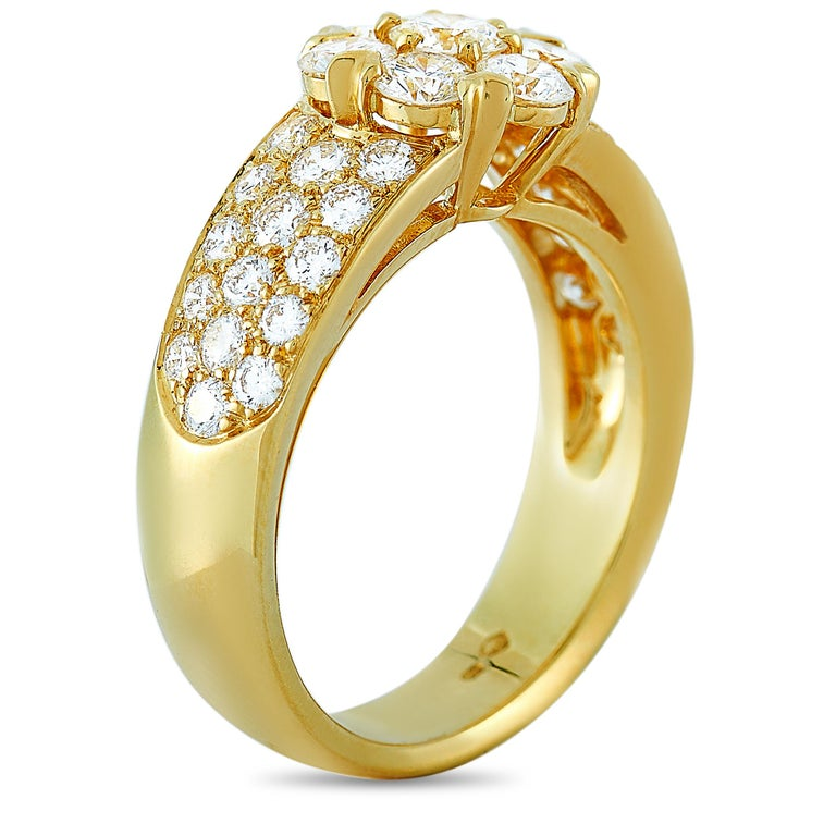 """The Van Cleef & Arpels """"Fleurette"""" ring is made of 18K yellow gold and embellished with diamonds that amount to 1.50 carats. The ring weighs 6.6 grams and boasts band thickness of 4 mm and top height of 5 mm, while top dimensions measure 20 by 9"""