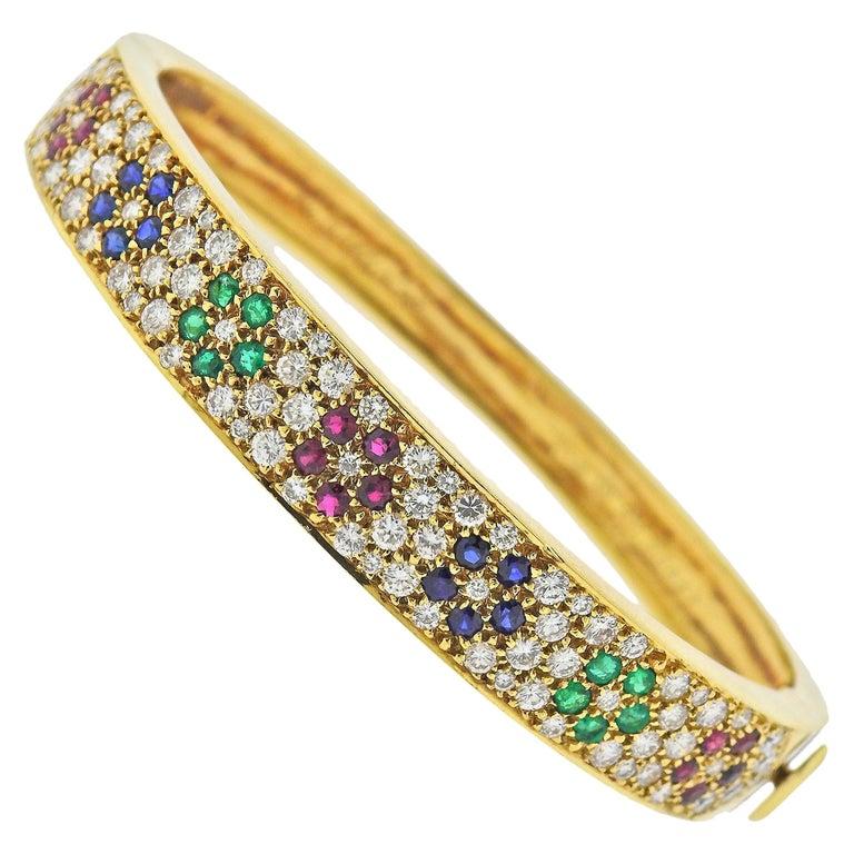 Van Cleef & Arpels Flower Emerald Sapphire Ruby Diamond Gold Bangle Bracelet For Sale