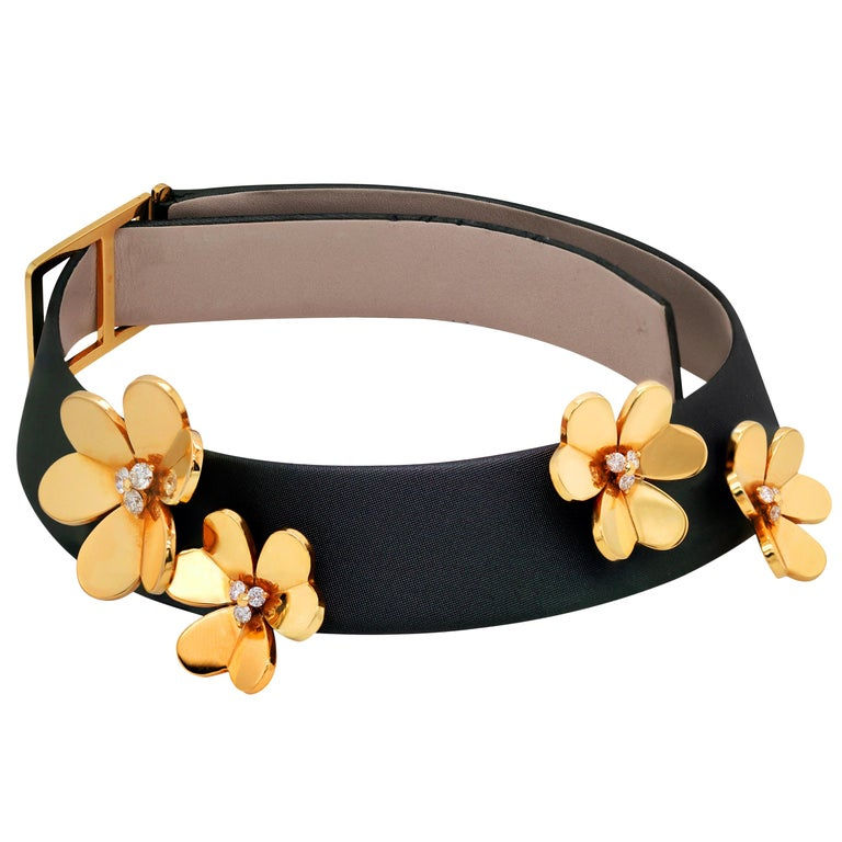 Van Cleef & Arpels Frivole 18 Karat Yellow Gold Diamond Collar Choker Necklace  This rare  choker necklace from the famous Frivole collection by Van Cleef and Arpels features four adjustable Ravena cords with four 18k yellow gold flowers accented