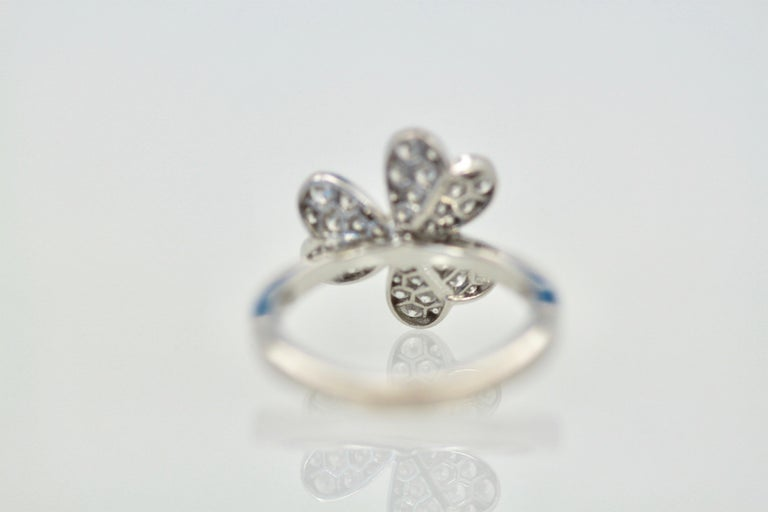 This Frivole Ring is the single flower ring it is signed numbered and comes with it's original box.  The size is 1.51 cm in diameter weights 5.08 grams and is size 54 US 6.5.  This Frivole ring is like petals in the wind delicate and lovely.