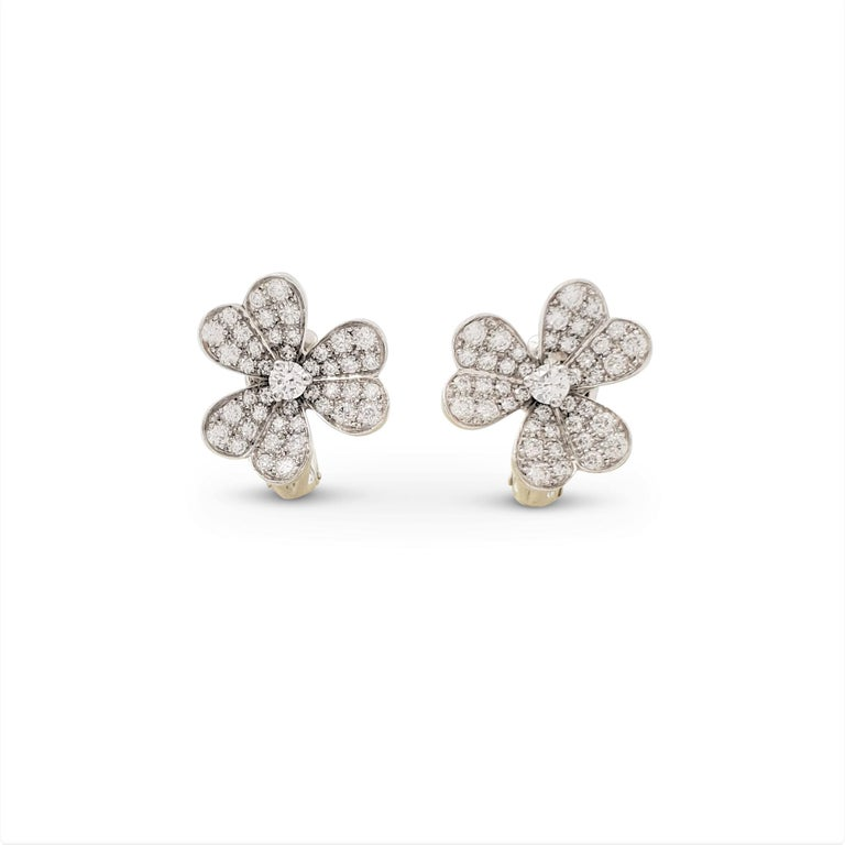 Authentic Van Cleef & Arpels 'Frivole' earrings feature 18 karat white gold heart-shaped petals set with sparkling round brilliant cut diamonds weighing a total of 1.61 carats total weight (E-F color, VS clarity). Signed VCA, Au750, with serial