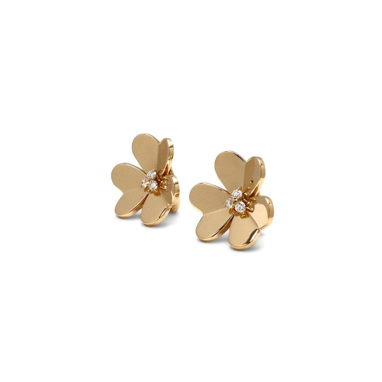 Authentic Van Cleef & Arpels 'Frivole' earrings feature mirror-polished 18 karat yellow gold heart-shaped petals set with three round brilliant cut diamonds at the center for an estimated 0.32 carats total weight. Signed VCA, 750, with serial number