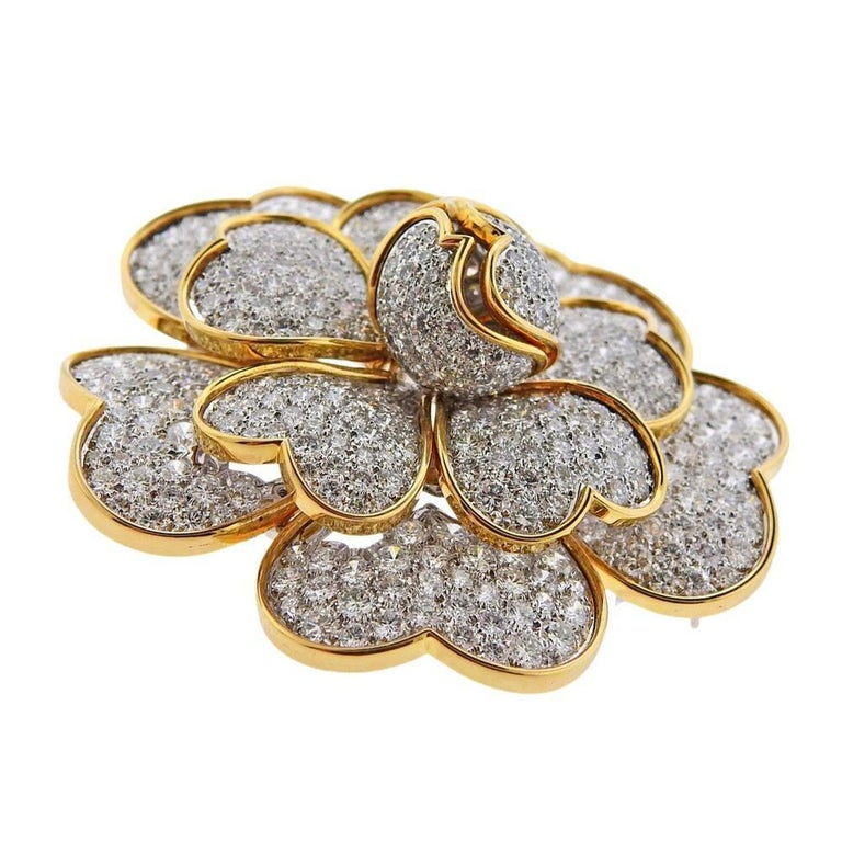 18k gold large Van Cleef & Arpels brooch with total of 17.95ctw in diamonds . Measures - 56mm x 55mm. Weights 50.7 grams. Marked Van Cleef & Arpels 750, 17.95ct 18k, M39812.
