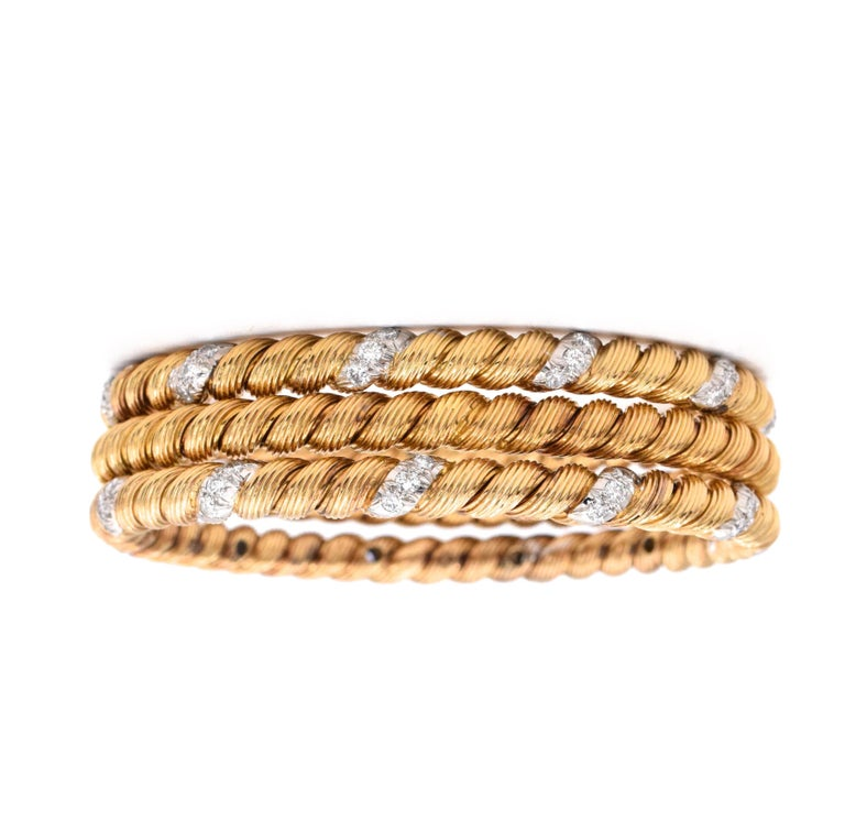 Beautiful twisted style Gold and Diamond Bangles by  Van Cleef and Arpels. Two  bangles with diamonds & one plain. gold.  18k yellow gold.  Signed VCA, FRANCE.  Size: Medium - Inner diameter is 2.5 inches Inner circumference is 7 inches