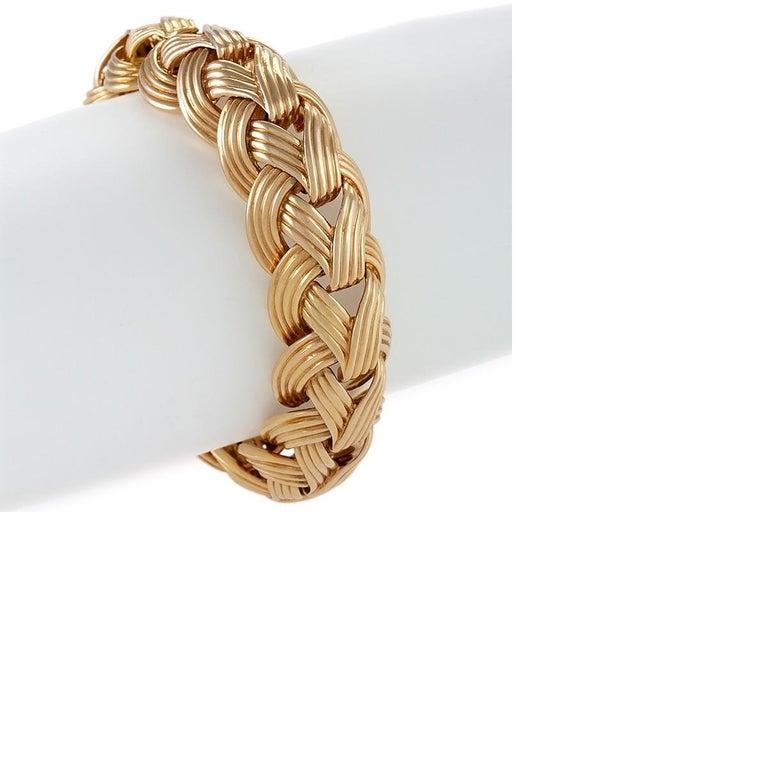 An 18 karat gold bracelet by Van Cleef & Arpels. The bracelet is composed of domed braided ribbed links.  The bracelet measures 8