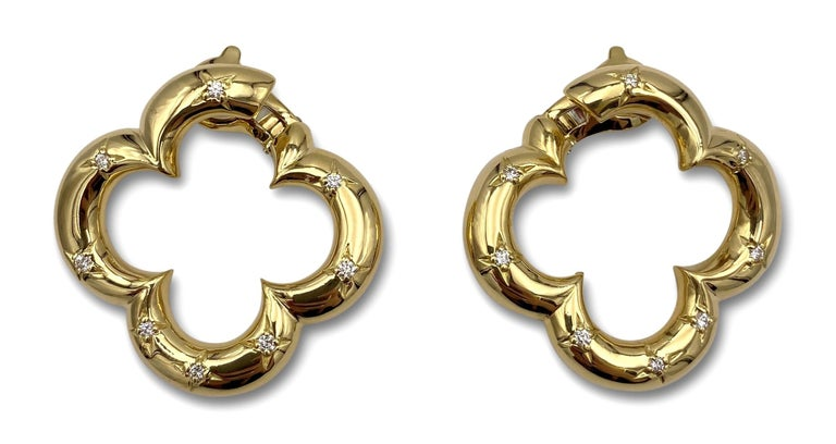 Authentic pair of Van Cleef & Arpels alhambra earrings made in 18 karat yellow gold with 16 round cut diamonds.  CIRCA 1998.  Signed VCA, 1998, 750, with hallmarks and serial numbers.  1.45 in x 1.53 in.  Level back clip on earrings
