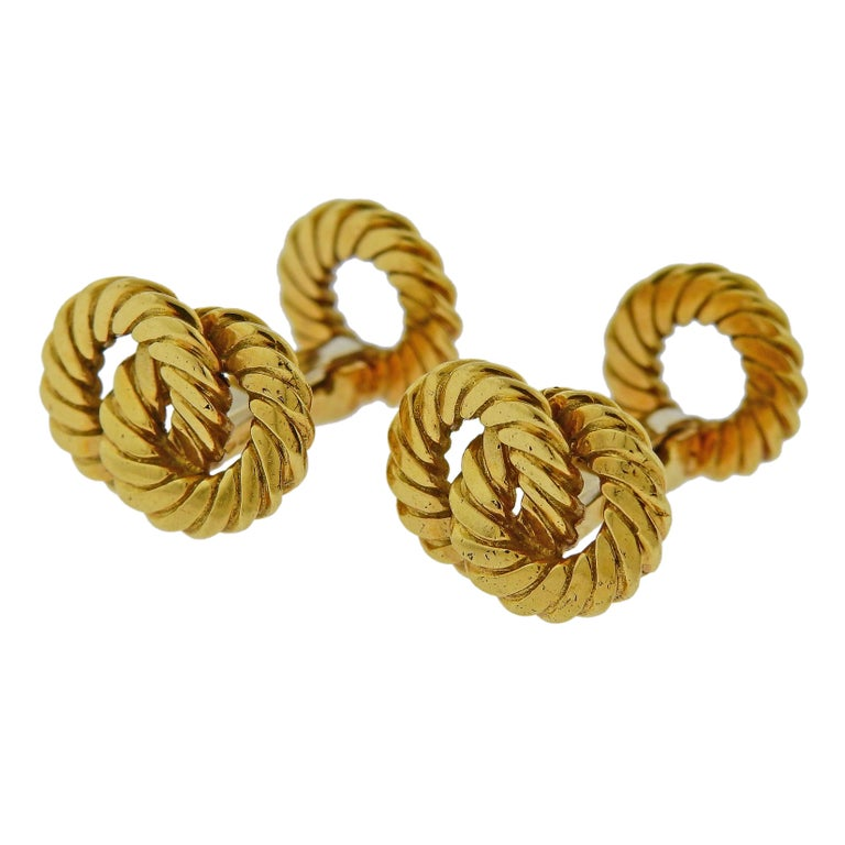 Pair of 18k yellow gold interlocked design cufflinks, crafted by Van Cleef & Arpels. Cufflink top - 17mm x 13mm, back - 12mm in diameter. Weight is 17.6 grams. Marked French eagle marks, VCA, 18kt, C 9050 R15.