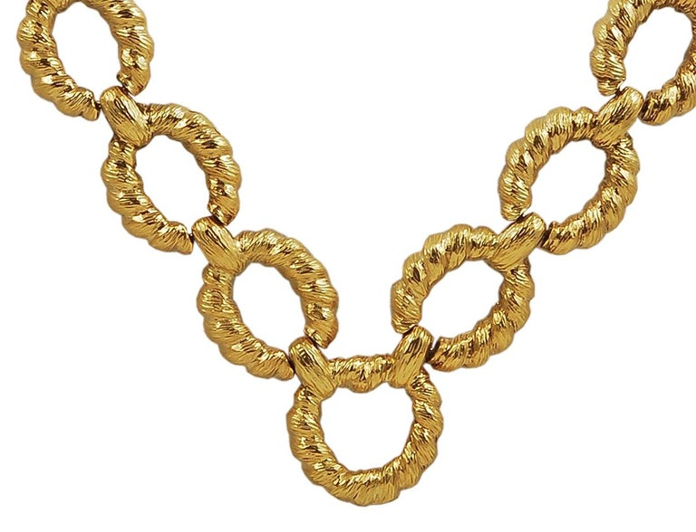An exquisite long link necklace by Van Cleef & Arpels, comprised of several links of rope textured 18k yellow gold, measuring approximately 23 inches in length. A transitional day-to-night piece perfect for any occasion.  Signed Van Cleef &
