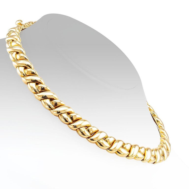 Van Cleef & Arpels gold necklace circa 1990. Designed as a tightly woven braid crafted in 18-karat yellow gold, signed Van Cleef & Arpels. We love that this beautiful, elegant necklace is designed by Van Cleef & Arpels. A brand that is recognized as