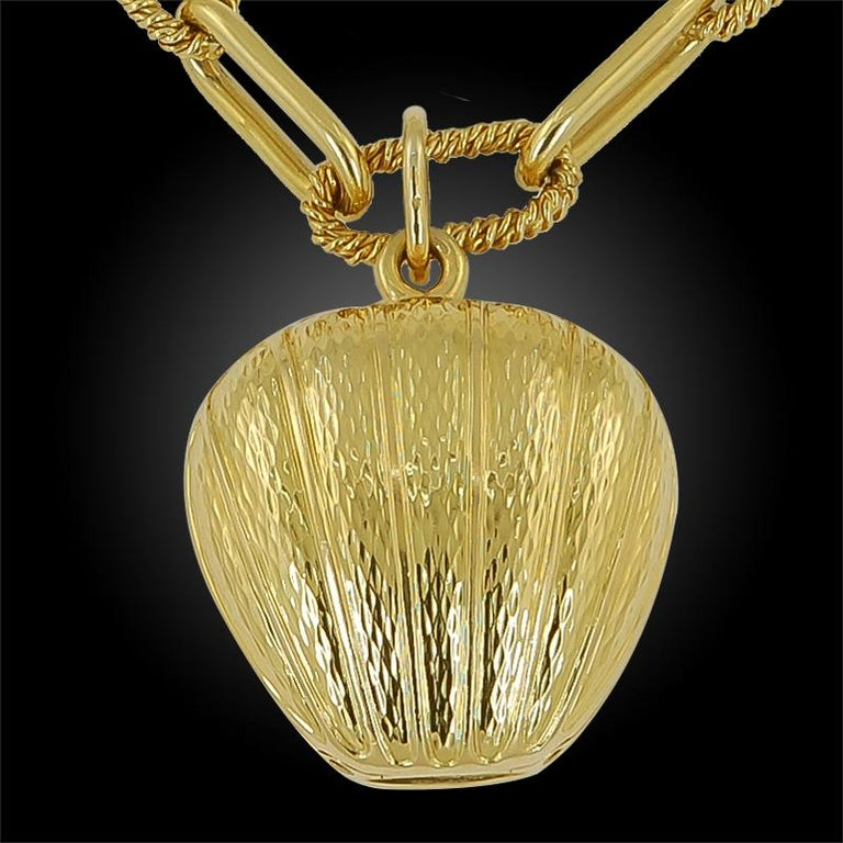 A charming 18k yellow gold heart pendant locket by Van Cleef & Arpels, suspended by a 14k link chain measuring approximately 30 inches in length, signed Van Cleef & Arpels. Circa 1990's