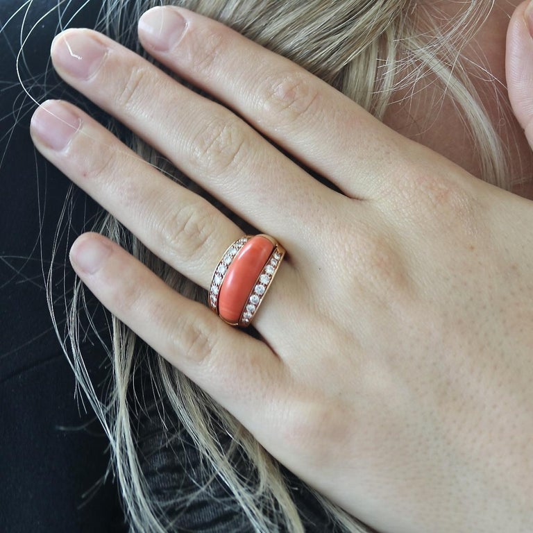 This uniquely diverse design allows 4 different looks for the same ring. Featuring four insert rings designed in forest green chrysoprase, navy blue lapis lazuli, orangish-red coral and white mother of pearl that fit snuggly in a ring of colorless