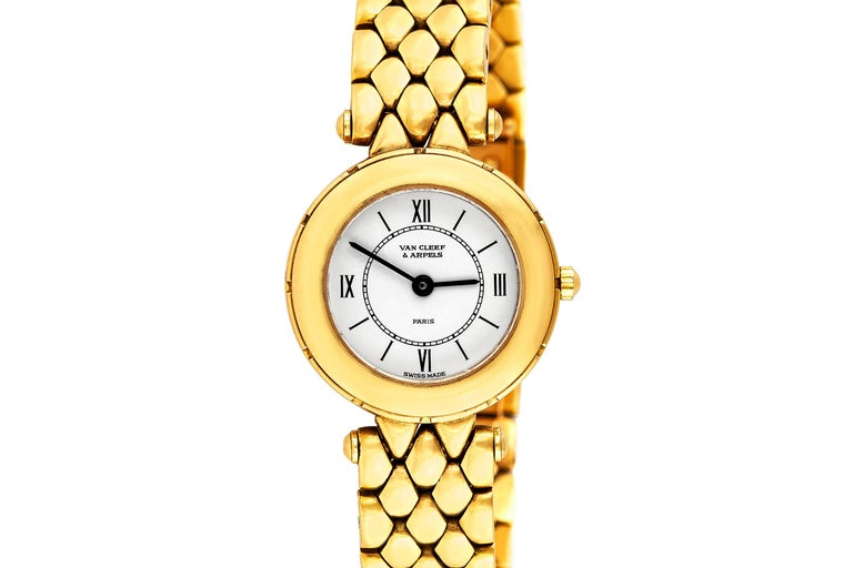 Vintage ladies watch, finely crafted in 18k yellow gold, with white dial.  Signed and numbered by Van Cleef & Arpels. Circa 1980's.