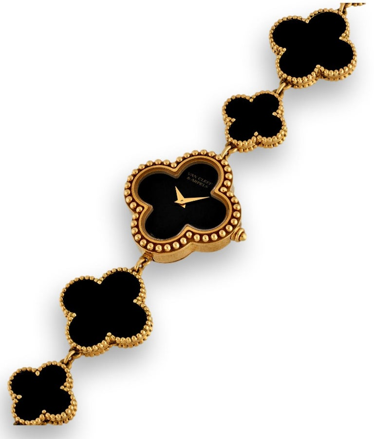 The Vintage Alhambra Bracelet Watch in yellow gold and onyx is an exquisite example of how Van Cleef & Arpels can combine the art of jewelry and watchmaking. It functions as both an exceedingly elegant bracelet and fine timepiece. The Van Cleef &
