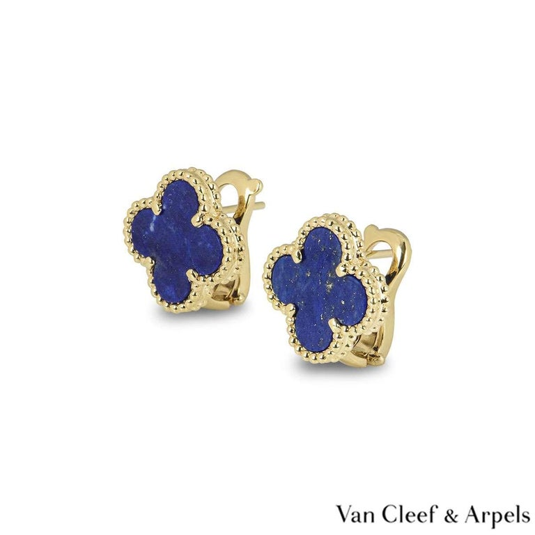 A beautiful pair of 18k yellow gold Van Cleef & Arpels earrings from the Sweet Alhambra collection. The earrings are composed of a four leaf clover motif with a lapis lazuli insert set to the centre, complimented by a beaded edge. The earrings