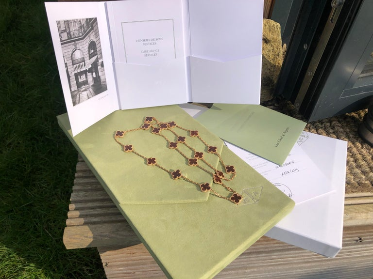 Gorgeous authentic rare and highly collectible Van Cleef & Arpels Vintage Alhambra letter wood 20 Motif necklace. This piece comes with an original pouch original box and authentic card.   STONES Letter wood  METAL TYPE  18K Rose