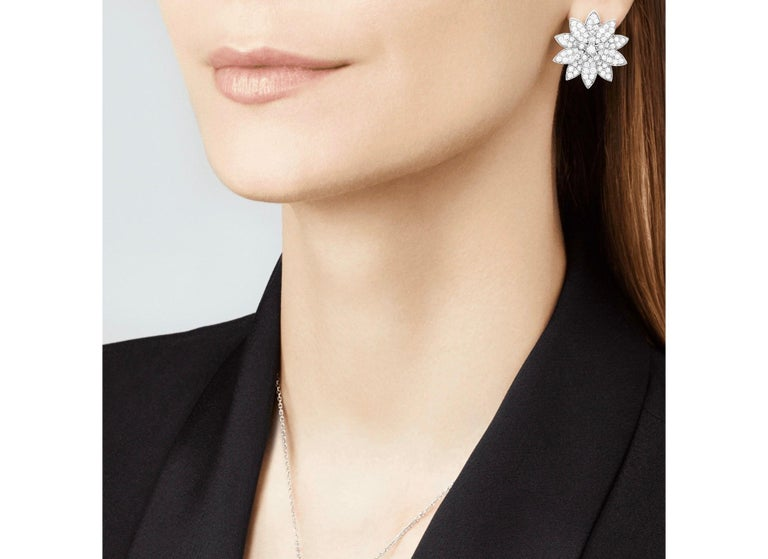 A symbol of beauty, purity and fulfillment, the lotus flower has inspired Van Cleef & Arpels to create dazzling and harmonious jewelry creations. Different types of diamond setting showcase the Maison's High Jewelry expertise.  Lotus earrings, white