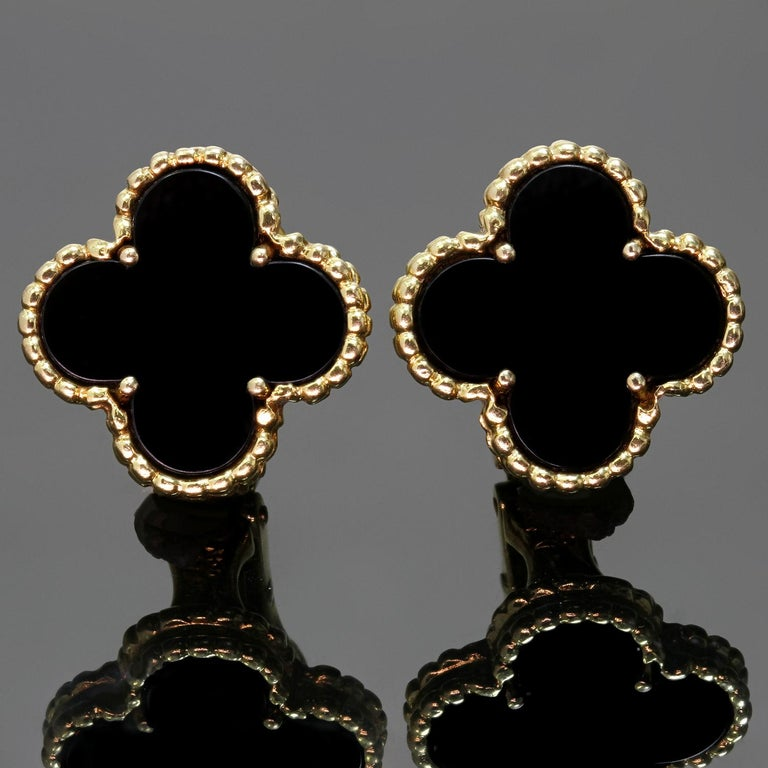 These elegant Van Cleef & Arpels clip-on earrings from the Vintage Alhambra collection are crafted in 18k yellow gold and feature a pair of lucky clover motifs inlaid with black onyx round bead settings. Made in France circa 2000s. Measurements: