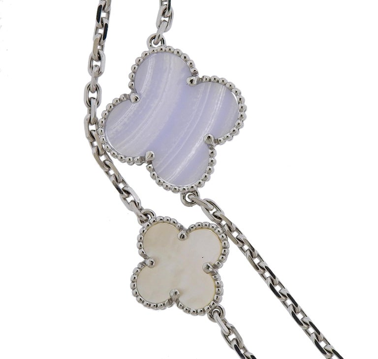 Long Magic Alhambra necklace by Van Cleef & Arpels, set with multi size clovers, set with mother of pearl and chalcedony, in 18k white gold. Necklace measures 48