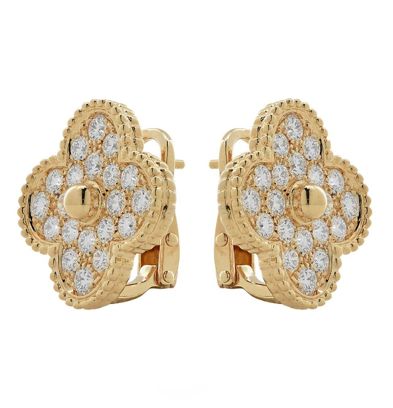 From the legendary House of Van Cleef & Arpels, these iconic Magic Alhambra earrings, finely crafted by hand in 18 karat yellow gold, are studded with 40 round brilliant cut diamonds weighing approximately 2.22 carats total, D-F color, VVS clarity.