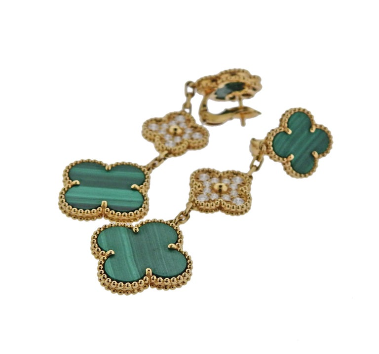 Pair of iconic 18k gold Magic Alhambra earrings by Van Cleef & Arpels, set with 0.96ctw in FG/VVS diamonds and malachite. Retail $16100. Come with box and COA. Earrings are 68mm long, bottom motifs are 20mm x 20mm and weigh 21 grams.
