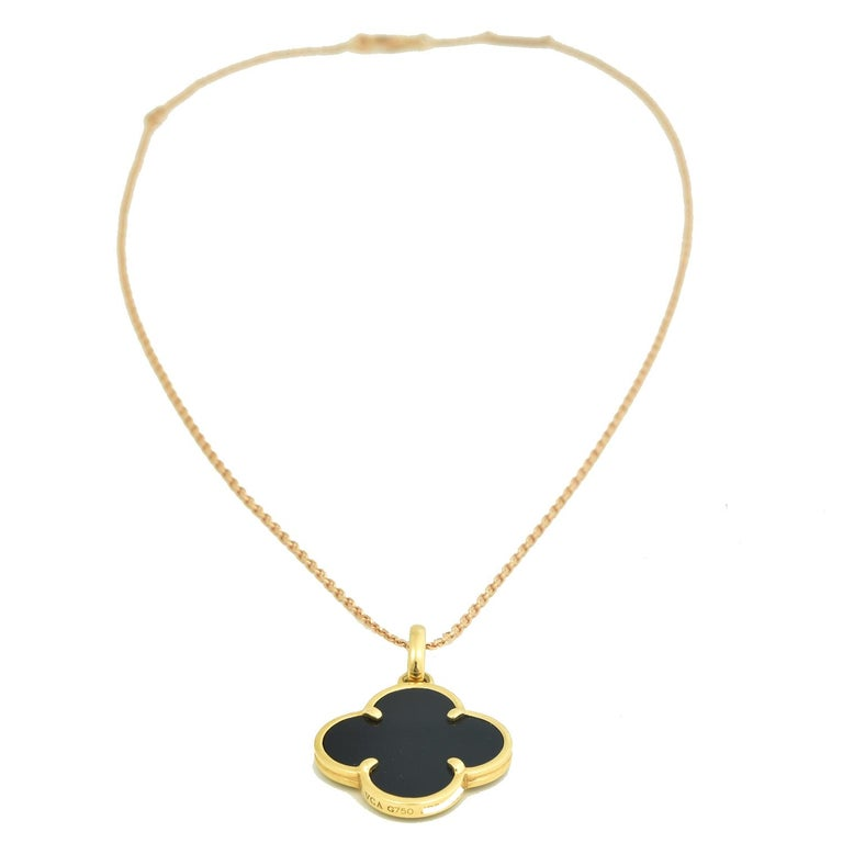 Designer: Van Cleef & Arpels  Collection: Magic Alhambra  Metal: Yellow Gold  Metal Purity: 18k  Stones: Black Onyx  Total Item Weight (g): 4.5  Dimensions: 20.05 x 22.72 mm  Thickness: 2.24 mm  Includes: 24 Month Brilliance Jewels Warranty  Chain