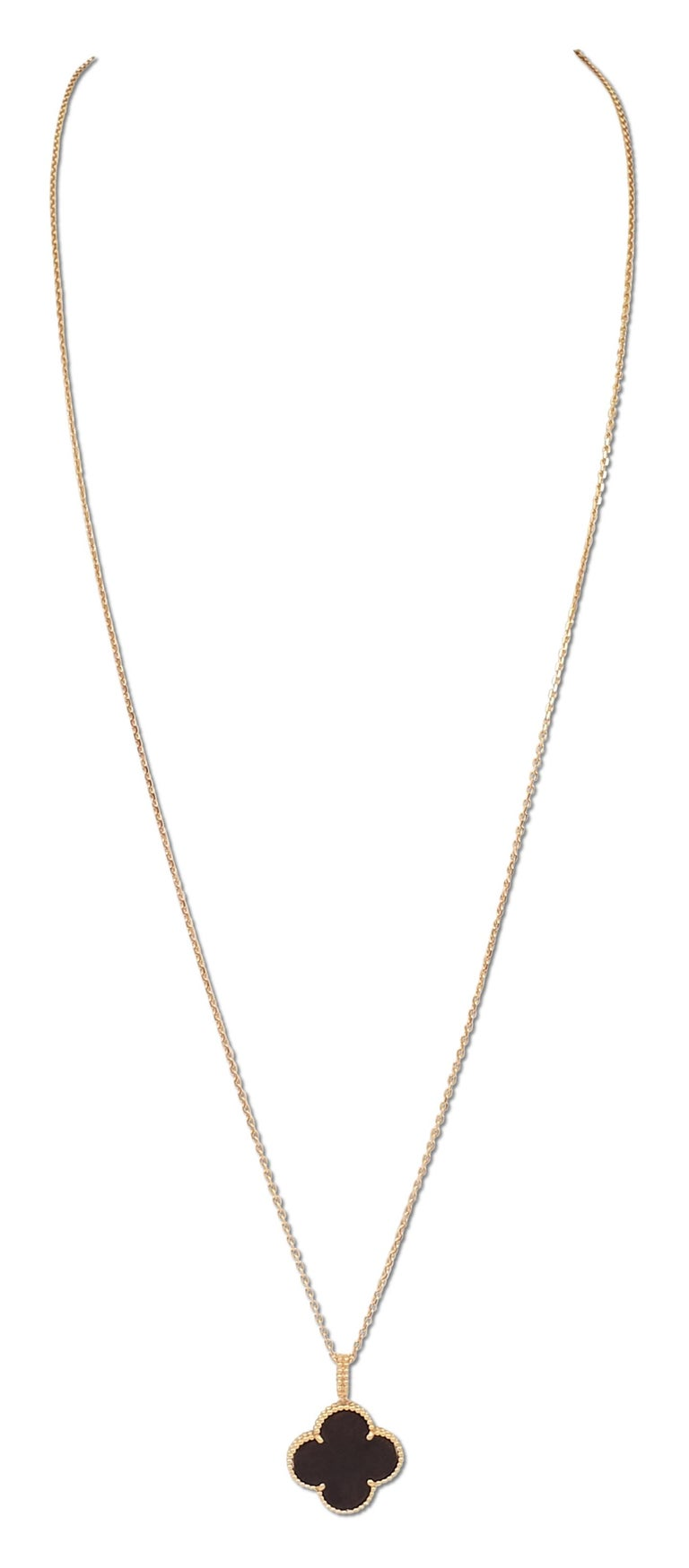 Authentic Van Cleef & Arpels Magic Alhambra long necklace features a single clover motif pendant crafted in 18 karat rose gold and set with carved wood. The pendant measures 26 x 26mm and hangs from a 90cm 18 karat rose gold chain. The necklace can