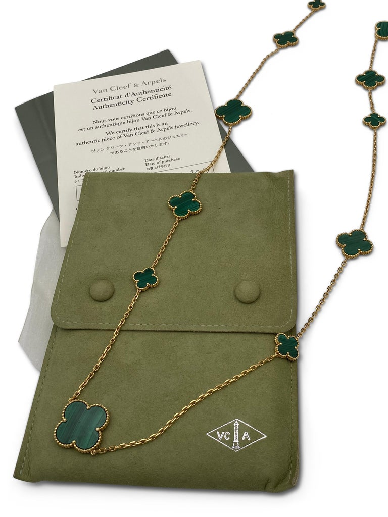 Authentic Van Cleef & Arpels 'Magic Alhambra' necklace crafted in 18 karat yellow gold featuring 16 clover leaf inspired motifs of malachite stones. Signed VCA, Au750, with hallmarks. Measures 50 3/4 inches in length. The necklace is presented with