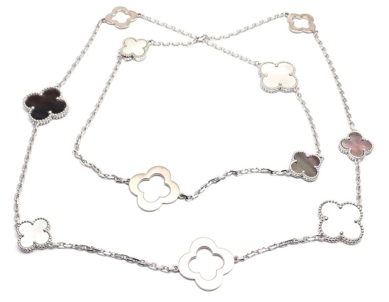 18k White Gold Magic White And Grey Mother Of Pearl Alhambra Necklace by Van Cleef & Arpels. With 3 x 21mm white & grey mother of pearl alhambra stones 4 x 15mm white & grey mother of pearl alhambra stones. This necklace comes with service paper