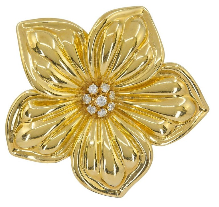 Van Cleef & Arpels Diamond Magnolia Brooch Earrings Suite in 18k Yellow Gold.  A trio of finely crafted jewels by Van Cleef & Arpels, composed of a brooch and pair of complimentary on-the-ear clips. This skillfully fabricated design looks as if it
