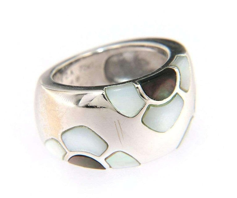 Van Cleef & Arpels Marqueterie Mother of Pearl Floral Ring, 18kt White Gold  Van Cleef & Arpels Marqueterie MOP Floral Ring 18kt White Gold Ring Size: 4.50 (US) Total Weight: 16.20 Grams Signed: VCA Stamped: 750  Condition: Offered for your