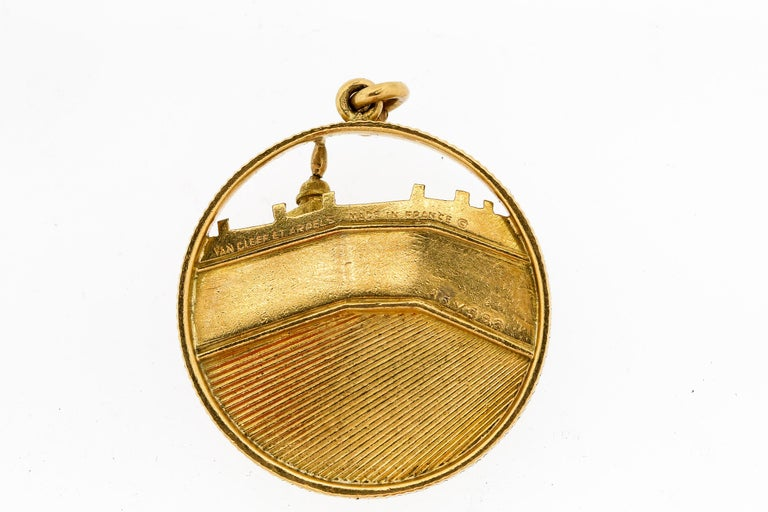 Iconic view of Place Vendome made in 18k gold by Van Cleef & Arpels. The charm dates to about 1960. The dimensional and 3-D rendering of the charm is classic details by VCA. The charm has a coin edge finish and is fluted and ridged to create texture