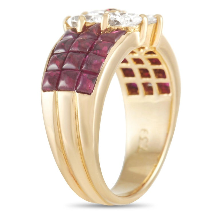 A scintillating array of gemstones make this piece from luxury brand Van Cleef & Arpels impossible to ignore. It's covered in square-cut rubies with a total weight of 2.00 carats. At the center, heart-shaped diamonds totaling 2.00 carats come